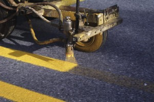 Up close view of a line striping machine